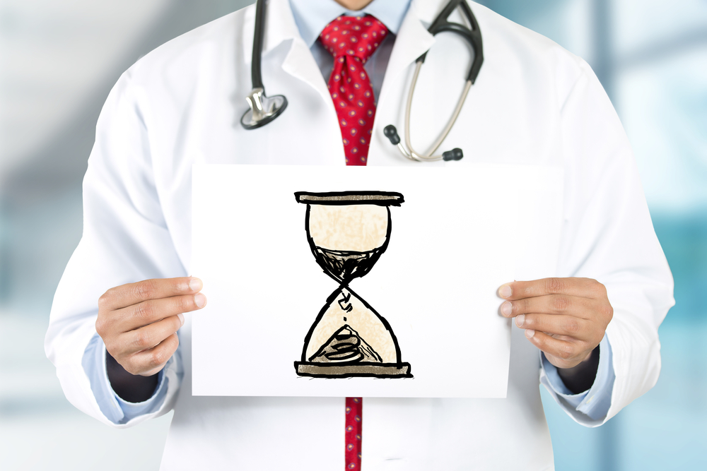 Dr with hour glass